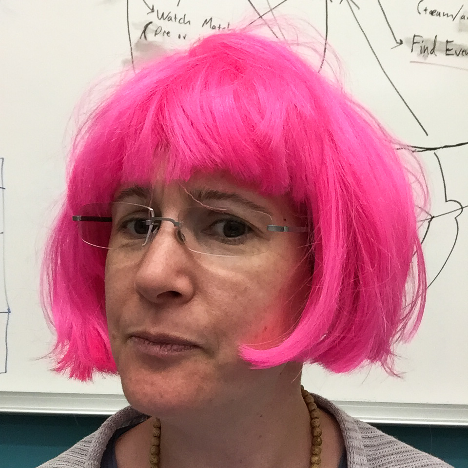 judith in a pink wig